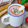Homemade tomato basil soup in the mug, served with mozzarella cheese stick and croutons, square format Royalty Free Stock Photo