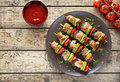 Homemade turkey or chicken meat shish kebab skewers with ketchup Royalty Free Stock Photo