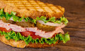 Homemade Turkey Sandwich with Lettuce Tomato Onion Royalty Free Stock Photo