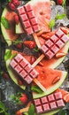 Homemade watermelon strawberry popsicles on ice with fresh fruits Royalty Free Stock Photo