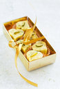 Homemade white chocolate candy heart with lemon and pistachios in gift box selective focus Royalty Free Stock Photo