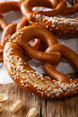 Homemade whole meal pretzels with salt close-up. Vertical Royalty Free Stock Photo