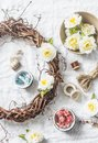 Homemade wreath with flowers and accessories for crafts creativity on a light background, top view. Royalty Free Stock Photo