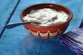 Homemade yogurt in a ceramic bowl and spoon Stock Images