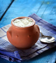 Homemade yogurt in a ceramic pot and spoon Stock Photo