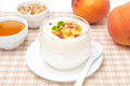 Homemade yogurt with honey fresh peaches and nuts horizontal Royalty Free Stock Image