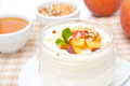 Homemade yogurt with honey peaches and nuts close up horizontal Stock Photography