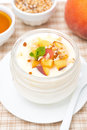 Homemade yogurt with honey peaches and nuts top view vertical Royalty Free Stock Photo