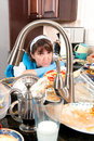 Homemaker washing dishes Stock Images