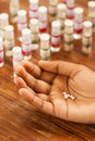 Homeopathic pills on hand Royalty Free Stock Photo