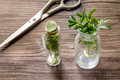Homeopathy. Store up medicinal herbs. Herbs in glass on wooden table background Royalty Free Stock Photo