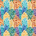 Seamless vector pattern with colorful houses decorated as a mosaic with many geometric details