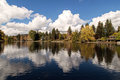 Homes on the rivermirror pond bend mirror in downtown is almost perfectly still in this autumnal image of peace located deschutes Royalty Free Stock Photo
