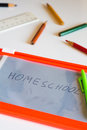Homeschool concept back to school board on table with handwritten text Stock Photos