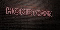 HOMETOWN -Realistic Neon Sign on Brick Wall background - 3D rendered royalty free stock image Royalty Free Stock Photo