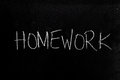 Homework on blackboard handwritten chalk text the Stock Photography