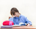 Homework girl is bored with Royalty Free Stock Image