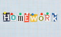 Homework the word in cut out magazine letters pinned to a background of blue graph paper Royalty Free Stock Photography