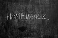 Homework written in chalk on blackboard texture Royalty Free Stock Photography