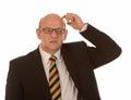 Homme chauve confus Photographie stock libre de droits