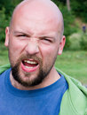 Homme chauve fâché Photographie stock libre de droits