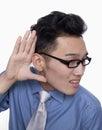Homme d affaires holding hand up à l oreille Photo stock