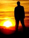 Homme dans le coucher du soleil Photos stock