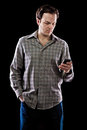 Homme texting Photographie stock