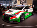 Honda civic wtcc geneva th salon de l auto at the stand among hybrid cars suvs sedans small hatchbacks and other verious road cars Stock Image