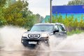 Honda pilot asha russia september black car at the city street during a strong flood Stock Image