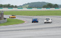 Hondas and subaru lapping sepang three very fast cars battling it out Stock Photography