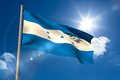 Honduras national flag on flagpole blue sky background Stock Photos