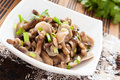 Honey agarics mushroom salad with chives Stock Photo