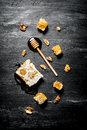 Honey background. Natural honey comb and a wooden spoon . Royalty Free Stock Photo