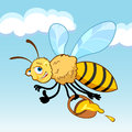 Honey bee cartoon in fly holding a basket with Royalty Free Stock Photo