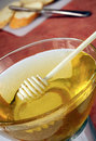 Honey bowl on table Stock Photo