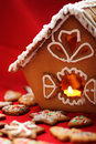 Honey cake house with a candle close up Stock Photos