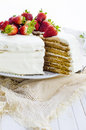 Honey cake with white cream and strawberries Stock Photos