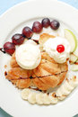 Honey croissant baked serves with ice cream banana grapes and apple Stock Image