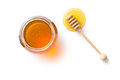 Honey dipper and honey in jar Royalty Free Stock Photo