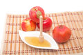Honey dipper with pomegranate and red apples rosh hashana concept Stock Images