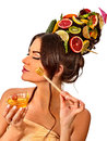 Honey facial mask with fresh fruits for hair and skin on woman head. Royalty Free Stock Photo