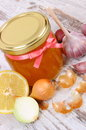 Honey in glass jar, onion, lemon and garlic, healthy nutrition and strengthening immunity Royalty Free Stock Photo