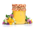 Honey in glass jars with flowers Stock Photo