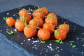 Honey glazed baby carrots with sea salt and thyme on a grey abstract background. Healthy eating concept. Fastening food