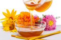 Honey holiday russian culture in a bowl flowers and candles Royalty Free Stock Images