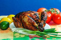 Honey jalepeno chicken beautifully roasted with sauce on white platter with scallion tomatoes lemon and lime Royalty Free Stock Photography