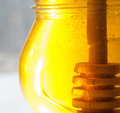 Honey jar closeup honey dipper golden honey glass pot healthy nutrition bee honey wooden tidbit Stock Image