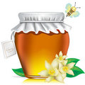 Honey jar with tag, flowers and honey bee Stock Photos