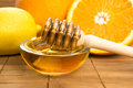 Honey with lemon and orange fruits fresh Stock Image